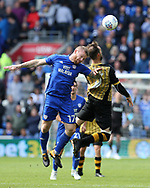Aron Gunnarsson of Cardiff city (l) jumps for a header with Steven Fletcher of Sheffield Wednesday ®. EFL Skybet championship match, Cardiff city v Sheffield Wednesday at the Cardiff City Stadium in Cardiff, South Wales on Saturday 16th September 2017.<br /> pic by Andrew Orchard, Andrew Orchard sports photography.