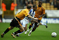 Photo: Rich Eaton.<br /> <br /> Wolverhampton Wanderers v Sheffield Wednesday. Coca Cola Championship. 28/10/2006. Wade Small who scored Wednesdays first goal tries to squeeze between Jamie Clapham left and Rohan Ricketss