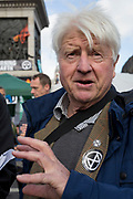 Stanley Johnson, the father of Prime Minister Boris Johnson joins environmental activists protesting about Climate Change during an occupation of Trafalgar Square in central London, the third day of a two-week prolonged worldwide protest by members of Extinction Rebellion, on 9th October 2019, in London, England.