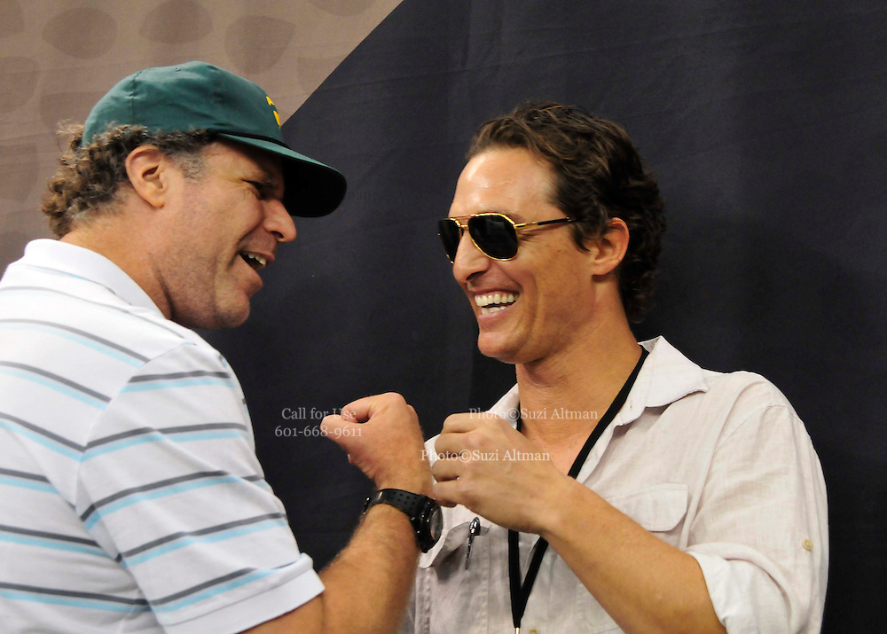 Actor Matthew McConaughey  and Actor Will Ferrell share a laugh on the sideliines befoer the New Orleans Saints played and beat the Seattle Seahawks.and his longtime girlfriend Camilia Alves strut down the New Orleans Saints sideline prior to the kickofff Sunday Nov. 21,2010 in New Orleans Louisiana in the Super Dome. The Saints went on to beat the Seahawks 34-19. Photo©SuziAltman.