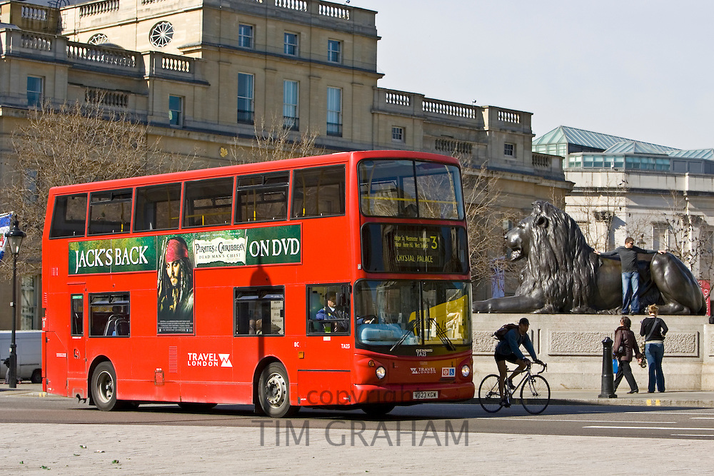 Public transport double-decker bus travelling in Trafalgar Square, London city centre, England, United Kingdom