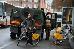© Licensed to London News Pictures. 25/11/2015. Brussels, Belgium. Belgian military continue to patrol the streets of Brussels  where the Metro transport system is now running and some schools have reopened following closure due to security fears. The Belgian capital has been on lockdown and the highest security alert due to fears of a terrorist attack following the recent attacks in Paris. Photo credit: Ben Cawthra/LNP
