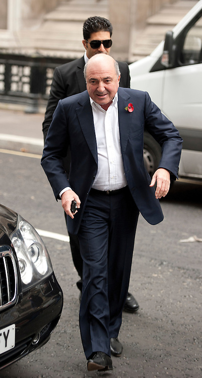 Boris Berezovsky arrives at The Royal Courts of Justice ahead of  Roman Abramovich  giving his evidence  in Central London, on October 31, 2011. Chelsea Football Club owner Roman Abramovich was accused in a British court Monday of intimidating fellow Russian tycoon Boris Berezovsky into selling him oil company shares at a large discount. Berezovsky, who lives in exile in Britain, accuses Abramovich of breach of trust and breach of contract over the sale of shares in Russian oil company Sibneft.