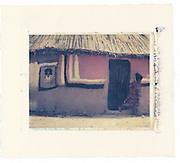 Oromo child runs out of her home which has been painted. Southern Ethiopia<br /> Image size 4x5, Matted 12x10  Edition of 25 <br /> Archival Pigment Print