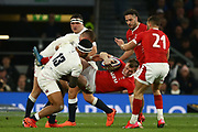 Owen Farrell and Manu Tuilagi of England tackle Nick Tompkins of Wales  during the Guinness Six Nations between England and Wales at Twickenham Stadium, Saturday, March 7, 2020, in London, United Kingdom. (Mitchell Gunn-ESPA-Images/Image of Sport)
