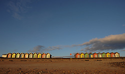 © Licensed to London News Pictures. <br /> 24/09/2014. <br /> <br /> Blyth, United Kingdom<br /> <br /> Beach huts at dawn on the promenade in Blyth, Northumberland.<br /> <br /> Photo credit : Ian Forsyth/LNP
