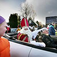 Nederland,Amsterdam ,22 november 2008..Sinterklaas arriveert in Amsterdam Noord en maakt in een cabrio,  Chrysler Sebring, onder begeleiding van Zwarte Pieten een tocht over de dijken..Sinterklaas of Sint-Nicolaas is de hoofdfiguur van het gelijknamige jaarlijkse kinderfeest dat op 5 december (Sinterklaasavond) in Nederland en op 6 december (de eigenlijke naamdag) in België en in enkele (voormalige) Nederlandse koloniën wordt gevierd. On a Sunday in the middle of November, St. Nicholas, known as Sinterklaas in the Netherlands, arrives in Amsterdam. It is the start of a 3 weeks during childrens' party with lots of candy and presents.