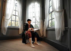 © Licensed to London News Pictures. 07/11/2011. London, UK. Peter aged 10, from The William Hogarth Primary School, wears clothes similar to what Hogarth would have worn in the 18th Century in the window of the house. The restoration project at Hogarth's House, built in 1750, in Chiswick, West London is completed today 7th November 2011. The house, once Hogarth's residence holds a collection of the artist's 18th century prints and engraving plates. The house suffered damage from a major fire during the restoration. Photo credit : Stephen Simpson/LNP