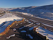 SHOT 3/2/17 7:45:01 AM - Aerial photos of Park City, Utah. Park City lies east of Salt Lake City in the western state of Utah. Framed by the craggy Wasatch Range, it's bordered by the Deer Valley Resort and the huge Park City Mountain Resort, both known for their ski slopes. Utah Olympic Park, to the north, hosted the 2002 Winter Olympics and is now predominantly a training facility. In town, Main Street is lined with buildings built primarily during a 19th-century silver mining boom that have become numerous restaurants, bars and shops. (Photo by Marc Piscotty / © 2017)