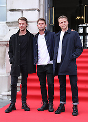 (left to right) Hugh Skinner, Jeremy Irvine and Josh Dylan arriving at the UK premiere of The Wife at Somerset House in London.