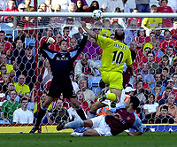 Photo: Greig Cowie.<br /> 20/09/2003.<br /> Barclaycard Premiership. Aston Villa v Charlton Athletic.<br /> Thomas Sorensen is pleased to see Claus Jensens effort fizz over the bar