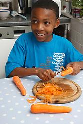 Teenager cutting carrots