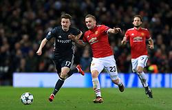 CSKA Moscow's Aleksandr Golovin (left) and Manchester United's Luke Shaw (centre) battle for the ball