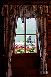 THEMENBILD - Blick aus dem Fenster auf Blumen im Regen. Die bewirtschaftete Alm, wo rund 800 Schafe und 55 Milchkühe im Sommer sind, besteht seit dem Jahre 1779 und wird von der Familie Aberger Dick geführt, Sie liegt unmittelbar bei den Kapruner Hochgebirgsstauseen, aufgenommen am 16. Juni 2017, Fürthermoar Alm, Kaprun, Österreich // Looking out the window on flowers in the rain. The Fuerthermoar Alm, where around 800 sheep and 55 dairy cows are in summer and is directly next to the Kaprun Hochgebirgsausauseen. The Mountain Hut exists since 1779 and is owned by the family Aberger Dick, taken on 2017/06/16, Kaprun, Austria. EXPA Pictures © 2017, PhotoCredit: EXPA/ JFK