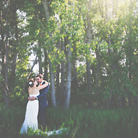 Wedding Photos by Connie Roberts Photography<br /> Bride and Groom snuggle in the trees