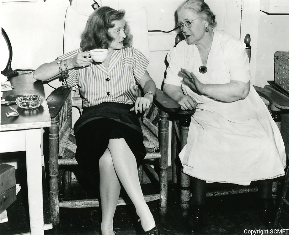 1943 Bette Davis chats with Mary Gordon at the Hollywood Canteen