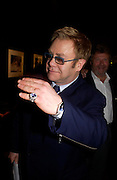 Sir Elton John. 4 Inches, A  Photographic Auction in aid of the Elton John Aids Foundation hosted by Tamara Mellon and Arnaud Bamberger. Christie's. 8 King St. London. 25 May 2005. ONE TIME USE ONLY - DO NOT ARCHIVE  © Copyright Photograph by Dafydd Jones 66 Stockwell Park Rd. London SW9 0DA Tel 020 7733 0108 www.dafjones.com