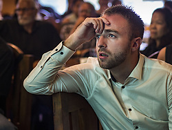 November 9, 2016 - Bangkok, Bangkok, Thailand - A person watching US election results in Bangkok reacts to news that Donald J. Trump had taken the lead in the Electoral College vote. Democrats Abroad Thailand met at the Roadhouse Barbecue, an American restaurant in Bangkok to watch election results come in. It was a somber election watch party as what was expected to be a Clinton victory turned into a Trump win. (Credit Image: © Jack Kurtz via ZUMA Wire)