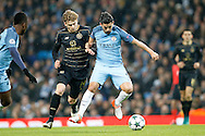 Celtic's Stuart Armstrong (14) and Manchester City's Nolito (9) during the Champions League match between Manchester City and Celtic at the Etihad Stadium, Manchester, England on 6 December 2016. Photo by Craig Galloway.