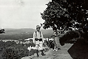 1930s Morocco French soldier with western woman standing at a mountain valley panoramic view