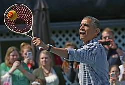 U.S. President Barack Obama plays tennis with young children during the White House Easter Egg Roll in Washington, DC, USA on April 1, 2013. Thousands of people are expected to attend the 134-year-old tradition of rolling colored eggs down the White House lawn that was started by President Rutherford B. Hayes in 1878. Photo by Mark Wilson/Pool/ABACAPRESS.COM  | 358933_023 Washington Etats-Unis United States