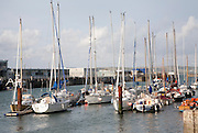Modern yachts at moorings in the harbour at Weymouth, Dorset, England, UK