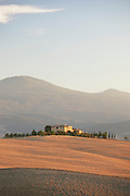 A villa in the rolling Tuscan landscape of the Val d'Orcia region in Italy