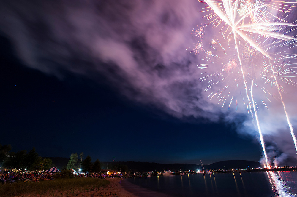 Fireworks over Lake Superior at Munising, Michigan during Fourth of July Independence Day celebrations.