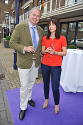 ANDREW GEMMELL and CATHERINE FULLER at a party to celebrate the launch of Bentley's The Collection held at 6 Square Rigger Row, Plantation Wharf, York Road, London SW11 on 25th June 2012.