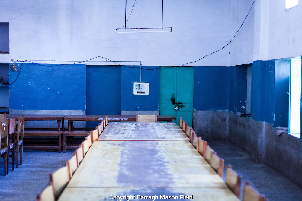 The boys canteen, each place is assigned to a boy who sits in the same place each day.  The staff are careful not to move furniture around as students negotiate space on memory.