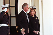 President Bill Clinton and first lady Hillary Clinton say goodbye to King Hussein of Jordan at the White House January 5, 1999 in Washington, DC. The King Hussein is on his way home after six months of cancer treatment in the United States.