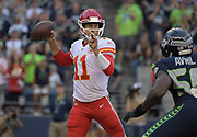 Aug 25, 2017; Seattle, WA, USA; Kansas City Chiefs quarterback Alex Smith (11) throws a pass under pressure from Seattle Seahawks defensive end Cliff Avril (56) during a NFL football game at CenturyLink Field.