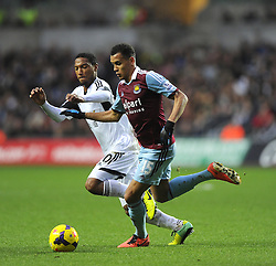 West Ham United's Ravel Morrison battles for the ball with Swansea City's Jonathan de Guzman - Photo mandatory by-line: Joe Meredith/JMP - Tel: Mobile: 07966 386802 27/10/2013 - SPORT - FOOTBALL - Liberty Stadium - Swansea - Swansea City v West Ham United - Barclays Premier League
