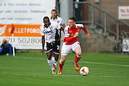 Crewe Alexandre's Matt Tootle gets away from from Port Vale's Mark Marshall. Skybet football league one match, Crewe Alexandra v Port Vale at the Alexandra Stadium in Crewe on Saturday 13th Sept 2014.<br /> pic by Chris Stading, Andrew Orchard sports photography.