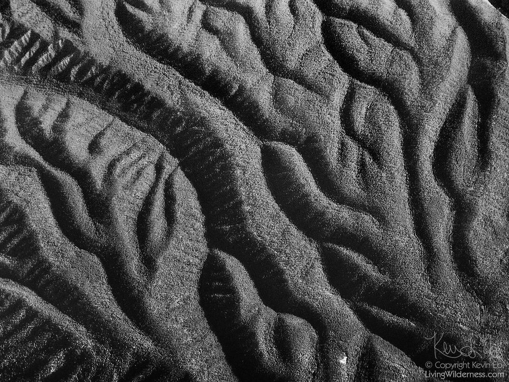The erosion patterns of the hills in the Sante Fe National Forest are visible in this aerial view captured from near El Valle, New Mexico.
