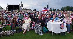 © Licensed to London News Pictures.22/08/15<br /> Castle Howard, North Yorkshire, UK. <br /> <br /> Hundreds of people attend the 25th anniversary of the Castle Howard Proms event near York. The theme of the event this year is a commemoration of the 75th anniversary of the Battle of Britain and the 70th anniversary of VE day and brings an evening of classic musical favourites celebrating Britishness to the lawns of Castle Howard.<br /> <br /> Photo credit : Ian Forsyth/LNP
