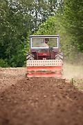 Male farm worker on tractor.