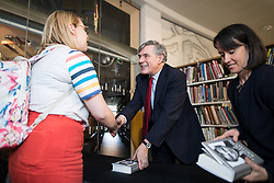 """© Licensed to London News Pictures. 16/11/2017. Manchester, UK. Former British Prime Minister GORDON BROWN signs copies of his book during a promotional tour for his book , """" My Life, Our Times """", at the Manchester Central Library . Photo credit: Joel Goodman/LNP"""