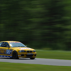 May 23, 2009; Lakeville, CT, USA; Bill Auberlen qualifies the Turner Motorsports BMW M3 Coupe for Grand-Am Koni Sports Car Challenge series competition during the Memorial Day Road Racing Classic weekend at Lime Rock Park.