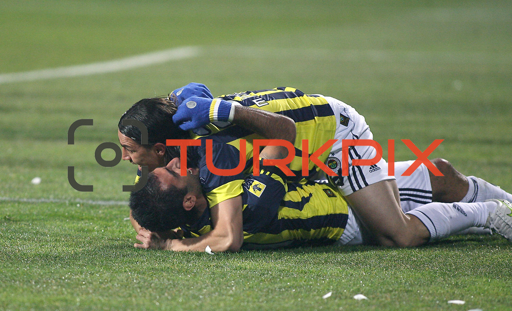 Fenerbahce's Mehmet TOPUZ and Selcuk SAHIN during their Turkish Superleague Derby match Besiktas between Fenerbahce at the Inonu Stadium at Dolmabahce in Istanbul Turkey on Sunday, 20 February 2011. Photo by TURKPIX