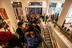 © Licensed to London News Pictures. 26/12/2019. . Queues form in Selfridges as Boxing Day bargain hunters brave the cold and the rain in Oxford Street for a chance to get large discounts on designer items at Selfridges this morning . Alex Lentati/LNP