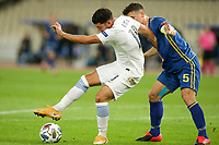 ATHENS, GREECE - OCTOBER 14: Dimitris Limniosof Greece and Herolind Shalaof Kosovo during the UEFA Nations League group stage match between Greece and Kosovo at OACA Spyros Louis on October 14, 2020 in Athens, Greece. (Photo by MB Media)
