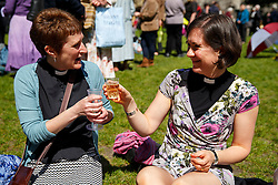© licensed to London News Pictures. London, UK 03/05/2014. Women priests enjoying a drink before walking to St Paul's Cathedral from Westminster Abbey in a procession to mark the twentieth anniversary of women becoming ordained priests in the Church of England. Photo credit: Tolga Akmen/LNP