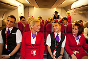 CRAWLEY, WEST SUSSEX, UK, OCTOBER 27TH 2011. Virgin Atlantic air stewardess and steward training aboard a simulated cabin at The Base training facility. (Photo by Mike Kemp for The Washington Post)