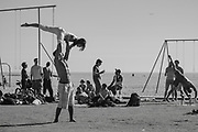 Gymnasts, athletesand exercise fans work out on the evocative sands in Sanata Monica