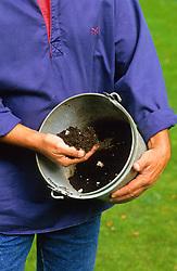 A bucket of mushroom compost