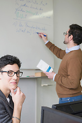 Teacher giving lecture in classroom School, Bavaria, Germany