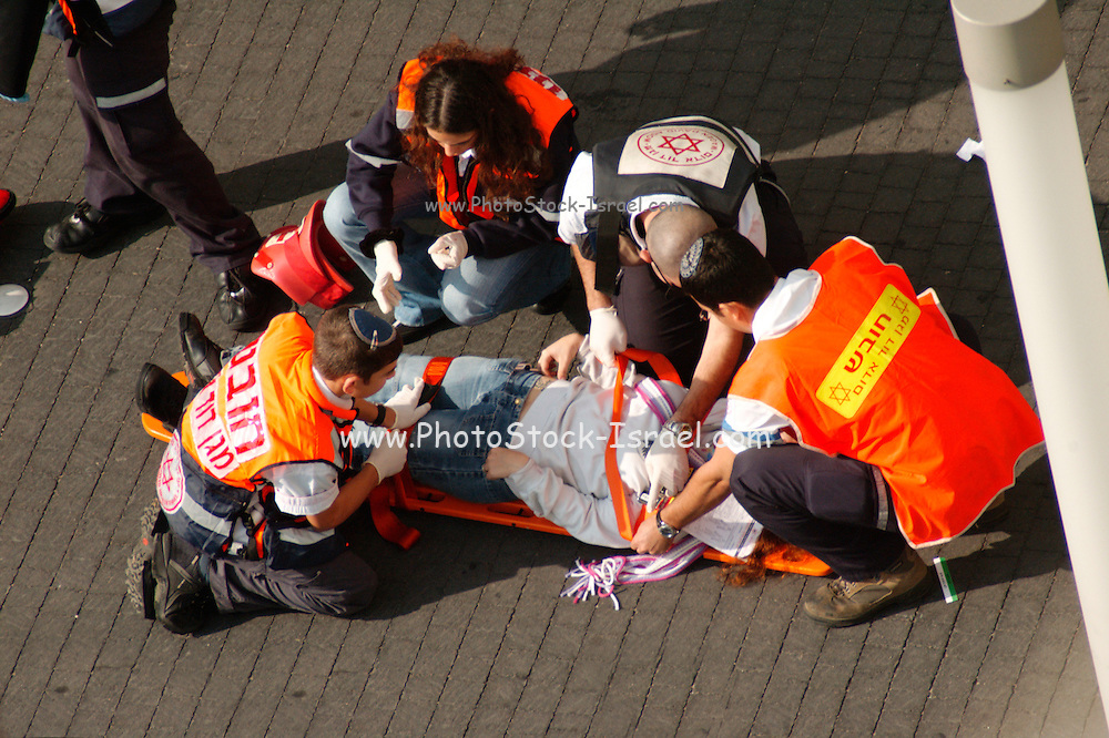Ambulance staff Evacuating the wounded during a fire drill in a highrise building