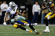 Dallas Cowboys wide receiver Dez Bryant (88) is tackled by the Pittsburgh Steelers defense at Cowboys Stadium in Arlington, Texas, on December 16, 2012.  (Stan Olszewski/The Dallas Morning News)