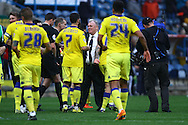 Leeds United Manager Steve Evans © congratulates his players after the game which they won 0-3. Skybet football league Championship match, Huddersfield Town v Leeds United at the John Smith's Stadium in Huddersfield, Yorks on Saturday 7th November 2015.<br /> pic by Chris Stading, Andrew Orchard sports photography.
